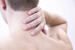πόνος λαιμών Άτομο με τον πόνο στην πλάτη αρσενικό σωμάτων μυϊκό Απομονωμένος στο άσπρο κόκκινο σημείο υποβάθρου υγειονομική περί Στοκ Φωτογραφίες