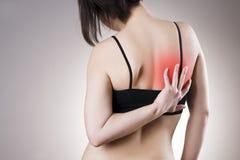Πόνος στην πλάτη των γυναικών Στοκ εικόνα με δικαίωμα ελεύθερης χρήσης