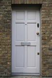 Πόρτα τουβλότοιχος Στοκ φωτογραφία με δικαίωμα ελεύθερης χρήσης