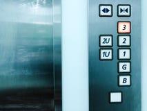 Πόρτες ανελκυστήρων και πατώματα αριθμού στοκ εικόνα