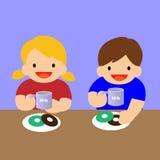 Πόσιμο γάλα κοριτσιών αγοριών Στοκ Εικόνες