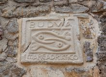 Πόλης έμβλημα Budva στο Μαυροβούνιο τρισδιάστατος αφηρημένος τρύγος εικόνων ανασκόπησης Στοκ Εικόνες