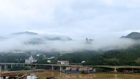 Πόλη βουνών σύννεφων Στοκ Εικόνα