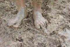Πόδια και λάσπη. Στοκ Εικόνες