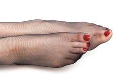Πόδια στις γυναικείες κάλτσες Στοκ Φωτογραφίες