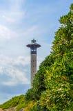Πύργος φάρων και μπλε θερινός ουρανός, η ασφαλής επιστροφή του shi Στοκ Φωτογραφία