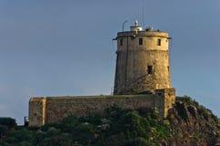 Πύργος Coltellazzo του φάρου Αγίου Efisio στη Νόρα, Σαρδηνία, Ιταλία Στοκ Φωτογραφίες