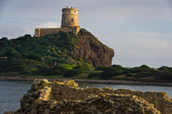 Πύργος Coltellazzo του φάρου Αγίου Efisio στη Νόρα, Σαρδηνία, Ιταλία Στοκ φωτογραφίες με δικαίωμα ελεύθερης χρήσης