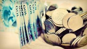 πώς τα χρήματα σώζουν Στοκ Εικόνες