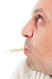 Πλάγια όψη του μισού προσώπου με το θερμόμετρο στο στόμα Στοκ Φωτογραφία
