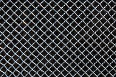 Πλέγμα μετάλλων ή πλέγμα αργιλίου στο μαύρο υπόβαθρο Στοκ Εικόνα