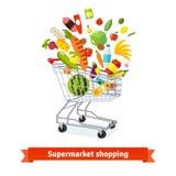 Πλήρες κάρρο παντοπωλείων αγορών που εκρήγνυται με τα αγαθά απεικόνιση αποθεμάτων