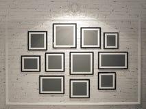 Πλαίσια στον άσπρο τουβλότοιχο Στοκ φωτογραφίες με δικαίωμα ελεύθερης χρήσης