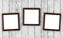 Πλαίσια φωτογραφιών στο ξύλινο υπόβαθρο Στοκ Φωτογραφίες