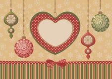 Πλαίσιο καρδιών Χριστουγέννων με τις διακοσμήσεις Στοκ Φωτογραφίες
