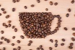 Πλαίσιο καφέ φλυτζανιών φιαγμένο από φασόλια καφέ Στοκ Φωτογραφίες