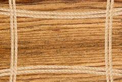 Πλαίσιο που αποτελείται από το σχοινί πέρα από το ξύλινο υπόβαθρο Στοκ Φωτογραφία