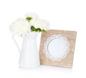 Πλαίσιο φωτογραφιών και ανθοδέσμη λουλουδιών Στοκ Εικόνες