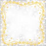 Πλαίσιο χαιρετισμού Χριστουγέννων των χρυσών χαντρών στο γκρίζο υπόβαθρο α θαμπάδων Στοκ φωτογραφία με δικαίωμα ελεύθερης χρήσης