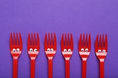 πλαστικό κόκκινο δικράνων Στοκ εικόνες με δικαίωμα ελεύθερης χρήσης