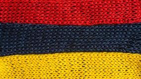 Πλεκτά τεμάχια των χρωμάτων σημαιών: κόκκινος, μπλε, κίτρινος Στοκ εικόνες με δικαίωμα ελεύθερης χρήσης