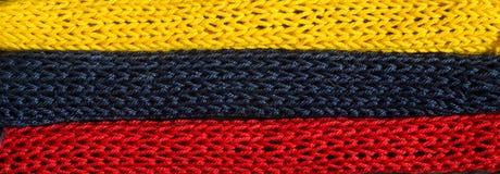 Πλεκτά τεμάχια των χρωμάτων σημαιών: κόκκινος, μπλε, κίτρινος Στοκ φωτογραφία με δικαίωμα ελεύθερης χρήσης
