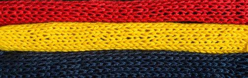 Πλεκτά τεμάχια των χρωμάτων σημαιών: κόκκινος, μπλε, κίτρινος Στοκ Εικόνες