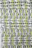 Πλεκτό σχέδιο υποβάθρου, γκρίζος, άσπρος και ανοικτό πράσινο Στοκ Φωτογραφία