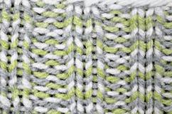 Πλεκτό σχέδιο υποβάθρου, γκρίζος, άσπρος και ανοικτό πράσινο Στοκ φωτογραφία με δικαίωμα ελεύθερης χρήσης
