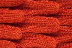 Πλεκτό ύφασμα της πορτοκαλιάς κινηματογράφησης σε πρώτο πλάνο χρώματος Στοκ Φωτογραφίες