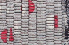 Πλεκτό Varicolored υπόβαθρο ταπήτων Στοκ εικόνα με δικαίωμα ελεύθερης χρήσης