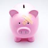 Πληγωμένη piggy τράπεζα Στοκ Εικόνες