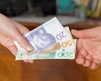 Πληρώνοντας με το σουηδικό νόμισμα, νέο σχεδιάγραμμα 2015 Στοκ Εικόνες