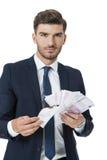 Πλούσια επιτυχή καίγοντας χρήματα επιχειρηματιών Στοκ εικόνα με δικαίωμα ελεύθερης χρήσης
