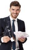 Πλούσια επιτυχή καίγοντας χρήματα επιχειρηματιών Στοκ Εικόνες
