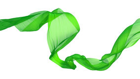 Ρέοντας πράσινο σατέν ένα άσπρο υπόβαθρο Στοκ φωτογραφία με δικαίωμα ελεύθερης χρήσης
