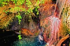 Ρέοντας ρεύμα σε έναν βράχο Στοκ Φωτογραφίες
