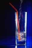 ρέοντας ύδωρ αχύρου γυαλ& Στοκ Φωτογραφία