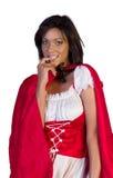 Ρίξτε λίγη κόκκινη οδηγώντας κουκούλα δαγκώνοντας το καρφί της που απομονώνεται στο λευκό Στοκ φωτογραφία με δικαίωμα ελεύθερης χρήσης