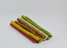 Ραβδί πρόχειρων φαγητών σκυλιών munch στοκ εικόνα