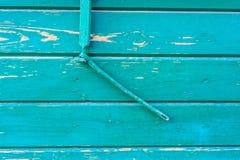 Ραγισμένη ζωγραφική στην ξύλινη επιφάνεια Στοκ Φωτογραφίες