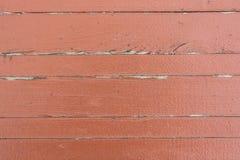 Ραγισμένη κόκκινο ζωγραφική στην ξύλινη επιφάνεια Στοκ Εικόνα