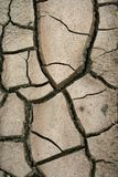 ραγισμένη ξηρά σύσταση λάσπη&s Στοκ Φωτογραφίες