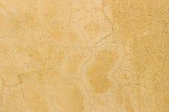 Ραγισμένη σύσταση χρυσή τοίχων κίτρινος και υποβάθρου στοκ φωτογραφίες