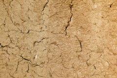 ραγισμένος τοίχος λάσπης Στοκ Φωτογραφία