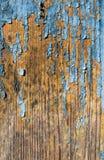 Ραγισμένο μπλε χρώμα σε ένα παλαιό πορτοκαλί ξύλινο σκηνικό Στοκ φωτογραφία με δικαίωμα ελεύθερης χρήσης