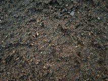Ρεαλιστικό υγρό χώμα μετά από το βρέχοντας τοπ υπόβαθρο σύστασης άποψης στοκ φωτογραφίες