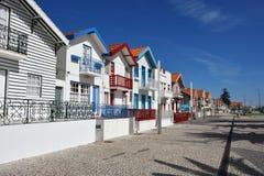 Ριγωτά χρωματισμένα σπίτια, Nova πλευρών, $μπέιρα Litoral, Πορτογαλία, ΕΥΡ Στοκ Φωτογραφία