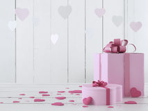 Ροζ παρόν με τις καρδιές Στοκ Φωτογραφίες
