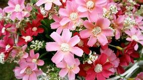 ροζ του τεχνητού λουλουδιού υφασμάτων Στοκ Εικόνες